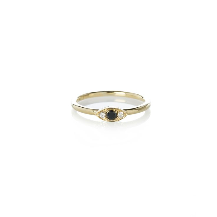 Dear Rae | Black Diamond Vue Ring | A mini trilogy diamond ring with a center 2.5mm brilliant cut black diamond, and two 1.5mm brilliant cut white diamonds set in 9ct yellow gold.  #DearRae #DearRaeJewellery #DiamondRings #ColourDiamonds #EngagementRings #PaveDiamondRings #EyeJewellery #Eyes #BlackDiamondRings