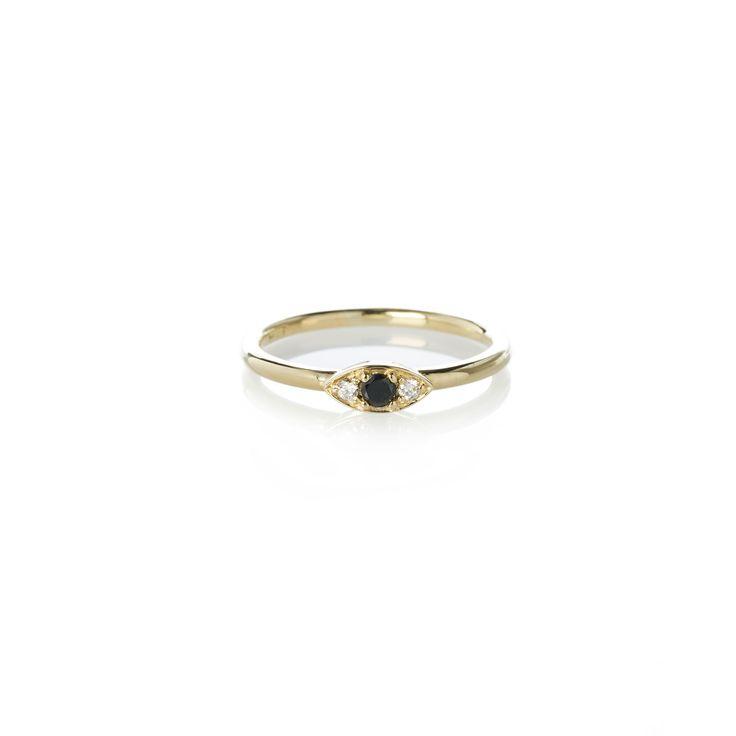 Dear Rae | Black Diamond Vue Ring | A mini trilogy diamond ring with a center 2.5mm brilliant cut black diamond, and two 1.5mm brilliant cut white diamonds set in 9ct yellow gold.  #DearRae #DearRaeJewellery #DiamondRings #ColourDiamonds #EngagementRings #PaveDiamondRings #EyeJewellery #Eyes #BlackDiamondRings
