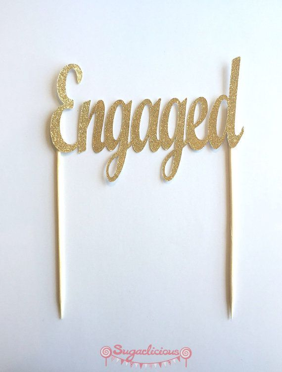 GOLD GLITTER ENGAGED CAKE TOPPER  • 1 x Gold Glitter Engaged single sided Cake…