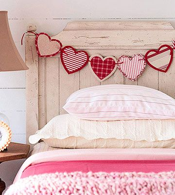 Hearts on a String Give your headboard a little love. Dress it up with a strand of sweet streamers. Cut and then sew together layers of scrap fabric or felt. String them together with a pretty ribbon and attach horizontally across your headboard. Try the same concept with handkerchiefs, clothespins, and twine for a vintage feel.