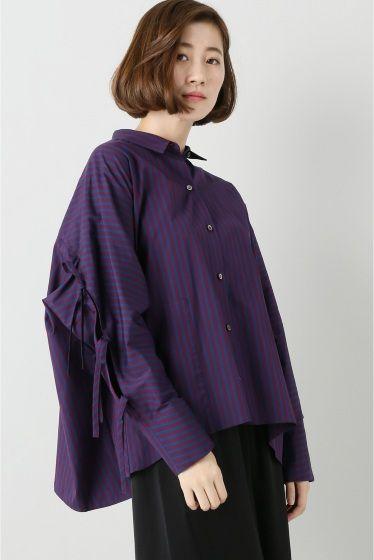 uemulo munenoli 袖リボン付ストライプシャツ  uemulo munenoli 袖リボン付ストライプシャツ 32400 2016AW FIGARO Paris たっぷりとしたシルエットでマニッシュなメンズっぽさがあるストライプシャツ コンパクトなカラーやすっきりとした袖口のシルエット抜け感のある衿元は女性らしさをぐっと引き出してくれます シャツに特化したブランドならではのディテールへのこだわりが感じられます なんといってもポイントはバックスタイル 腕がチラリと見えるお袖のデザインが魅力 リボンがアクセントになりいつものシャツスタイルも一段とオシャレにクラスアップしてくれます お袖が開き肌がちらりと見える女性ならではのセクシーさとカッティングのエレガントさ たっぷりとした素材感には少しメンズっぽさも感じられるまさにFIGARO Paris今季のテーマLady&Dandyにぴったりです uemulo munenoli 上榁むねのりによるレディースシャツブランド…