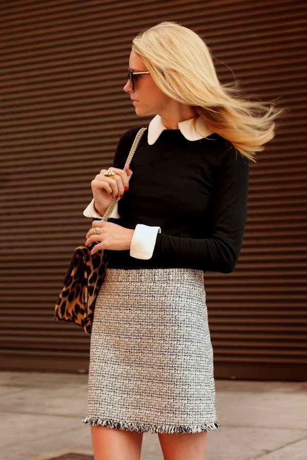 I love how classy and yet fresh this look is! The top half is super sleek with a classic black knit and white button down. The bottom half though rocks a chick patterned skirt and a fun bag!