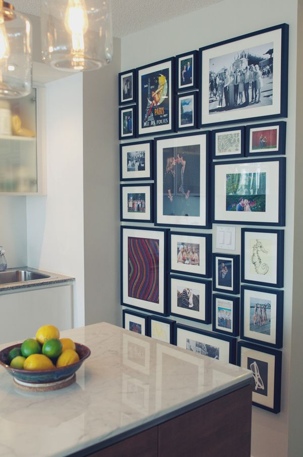 There may be a bit of work involved to create a streamline look for your wall grouping, but using craft paper cut to size, and measuring everything multiple times will help achieve perfection the first time around.