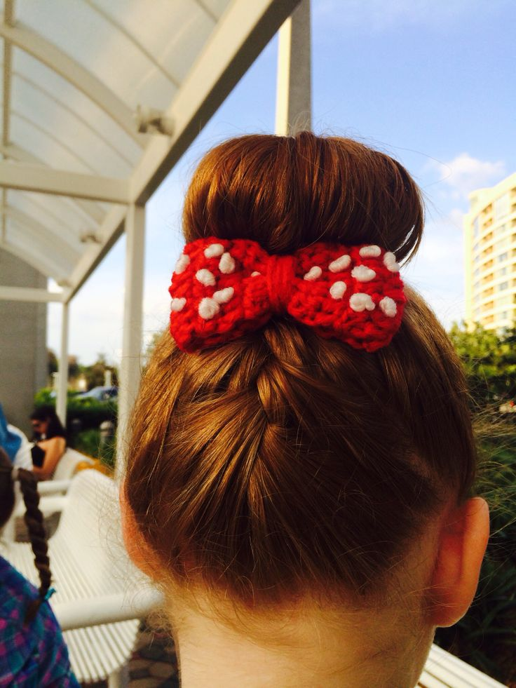 Ryleigh's hair for Disney World. Upside down French braid into a sock bun with a Minnie Mouse bow.
