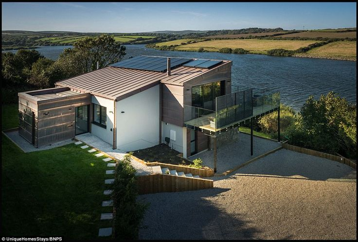 Picturesque: The three-storey home boasts stunning views of a reservoir near Penzance in Cornwall