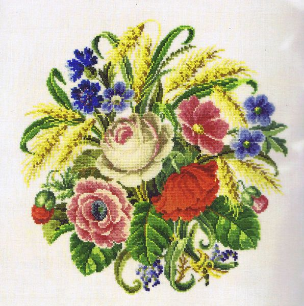 A lovely traditional flower picture with cornflowers and wheat.