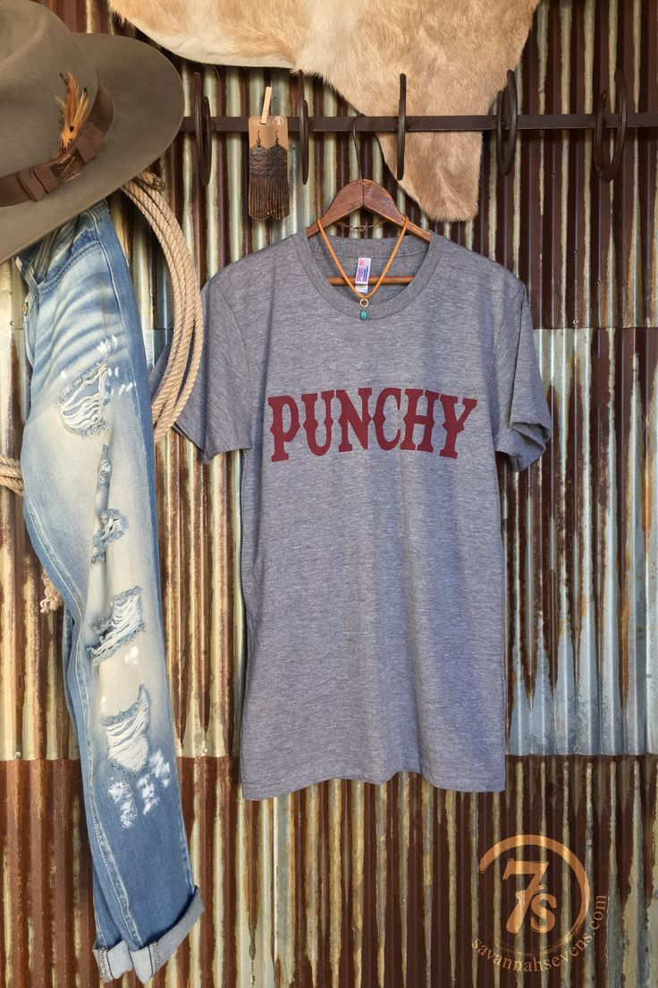"The Punchy- ""Punchy"" graphic t-shirt. Cranberry western graphics. Super soft heather gray. Unisex fit. Longer fit thru the  bodice. Fits true to size."