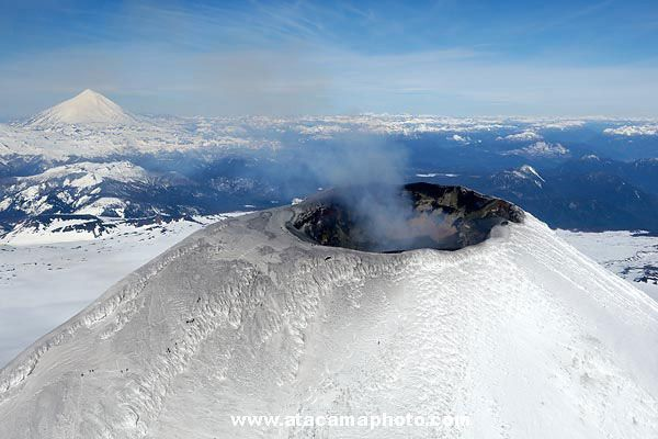 Aerial view of Villarica volcano in winter - see Lanin in the background, Chle