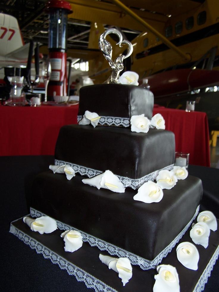 John and Kristie's black diamond wedding cake. Chocolate cake with chocolate ganache. Those are white gum paste calla lillies on top. Congrats John and Kristie. - Margaret