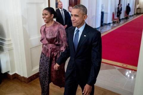President Barack Obama and first lady Michelle Obama arrive for a Presidential Medal of Freedom ceremony in the East Room of the White House, Tuesday, Nov. 22, 2016, in Washington.