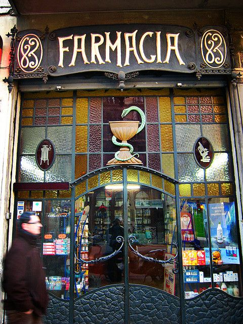 Art nouveau Entrance to the Farmacia. Stained Glass and Iron. Love the snake wrapped around  a goblet on top of the door.