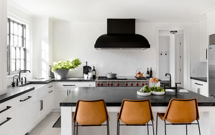 Blackened Stainless Steel Hood we fabricated for a home in Scarsdale - HOUSE TOUR:  A Fashion-Forward Home That's Surprisingly Kid-Friendly  - ELLEDecor.com