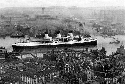A second deathship—the misidentifed Cap Arcona. Prior to its conversion for military service, the German Schnelldampfer (high speed steamer) Cap Arconais seen gliding into Hamburg. At 206 meters in length, 26 meters wide and powered by 24,000 horsepower engines, the cruise ship was rated to carry at full capacity 2150 passengers. Twice that number, mostly concentration camp (KZ) prisoners, were crowded on board during its last voyage.