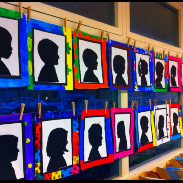 I printed a digital picture, glued it to tag board and cut out. The kids painted them black and glued them on the white paper. Next, they painted the large white paper to make the frame and that was that... Simple, original and beautiful!