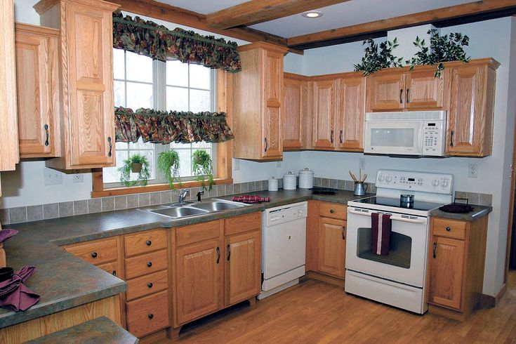White Kitchen Appliances With Wood Cabinets light oak with white appliances and wood floor. slate counter top