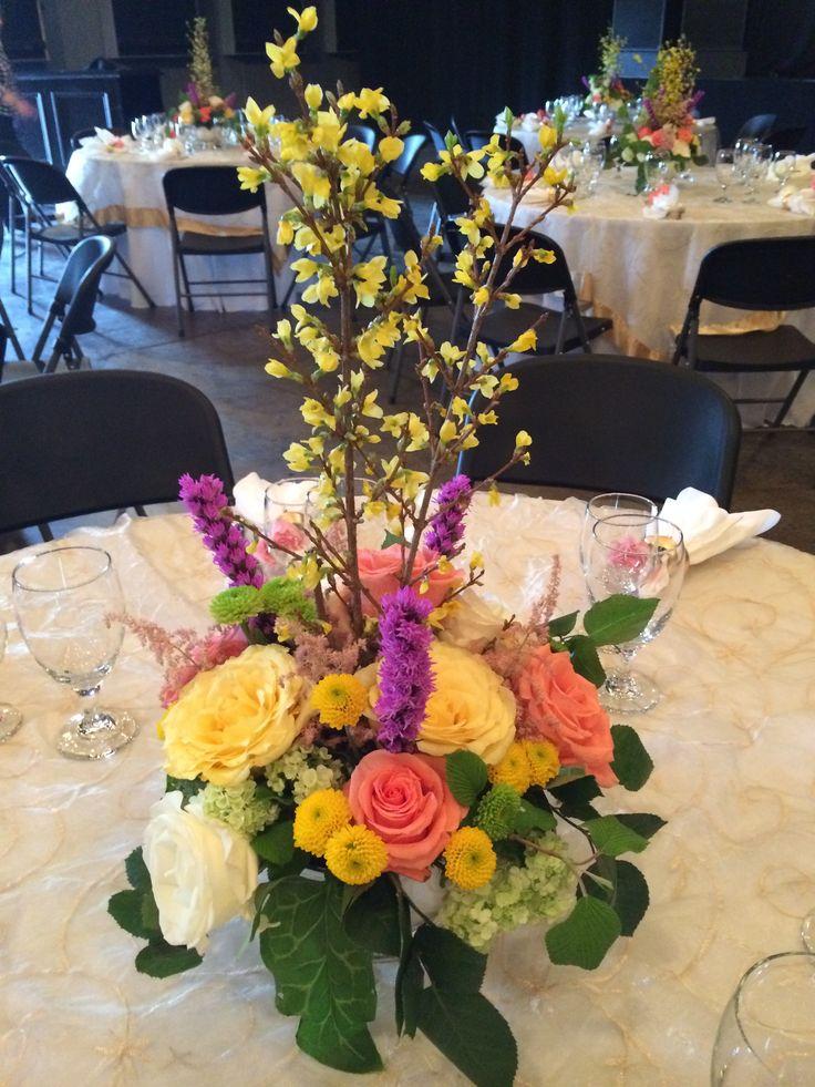 Forsythia luncheon arrangement by high cotton floral