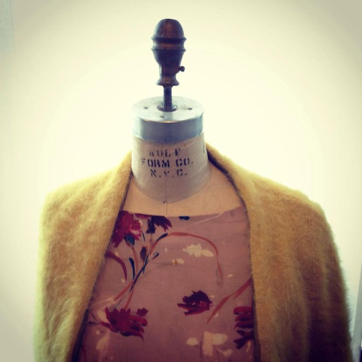 Yellow knitwear and floreal dress by Liis Japan