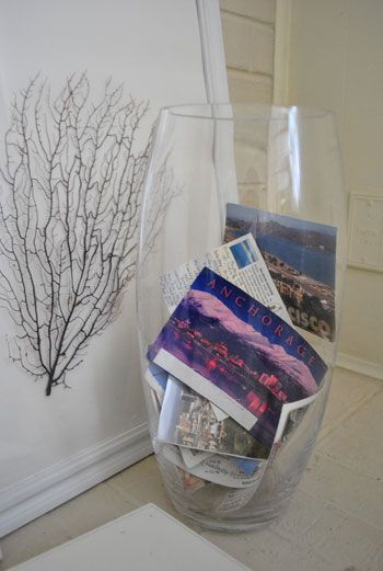 cool tradition: send a postcard to yourself whenever you travel and record a special memory from the trip. then, instead of tucking them away and out of sight, put them in a big glass jar as part of your decor!