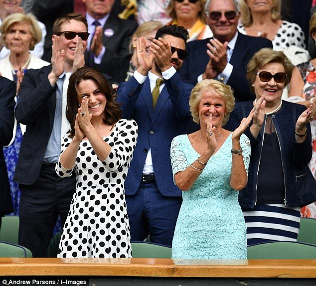 The Duchess of Cambridge couldn't contain her delight as she applauded Andy Murray for his... July 3 2017 white black-polka dot dress, black sandals, white handbag purse. What Kate wore
