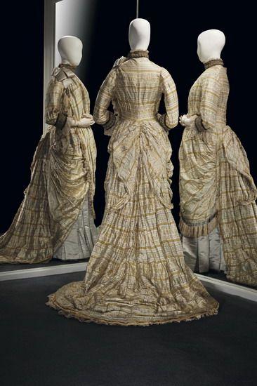 Circa 1879 Maternity dress by Worth. Silk, metallic thread, silk velvet, machine-made lace, and cotton.