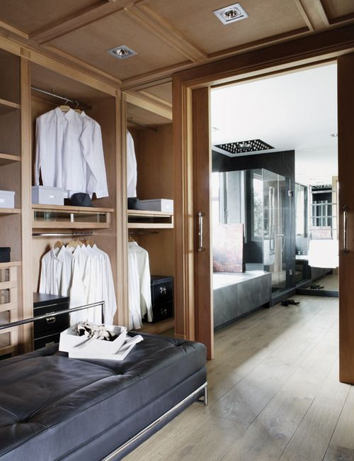Traditional ceiling detail and beautiful sliding door to separate this clean closet from the adjoining ensuite.