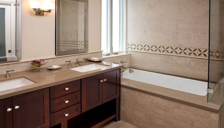 Caesarstone Mocha 2370 vanity top and tub deck, natural stone backsplash/ wall accent. Visit globalgranite.com for more countertop options.