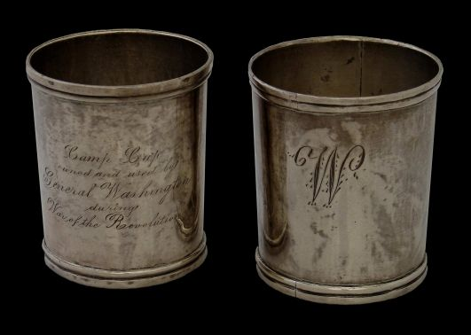 Washington's Camp Cups | These silver camp cups, with later commemorative inscriptions, were part of General George Washington's camp equipment during the American War of Independence. The original set of twelve cups, used to serve wine to aides and guests at the General's table, were made in the shop of Philadelphia silversmith Edmund Milne in August 1777.