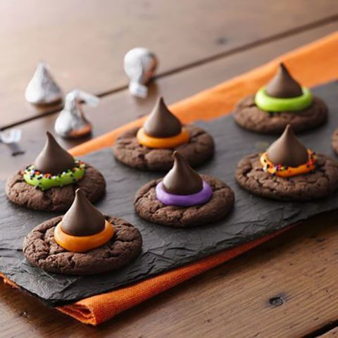 Hershey's Blossom Cookies get a Halloween makeover with chocolate cookie mix, a dollop of food dye-tinted frosting, and a kiss. Get the recipe at Betty Crocker.