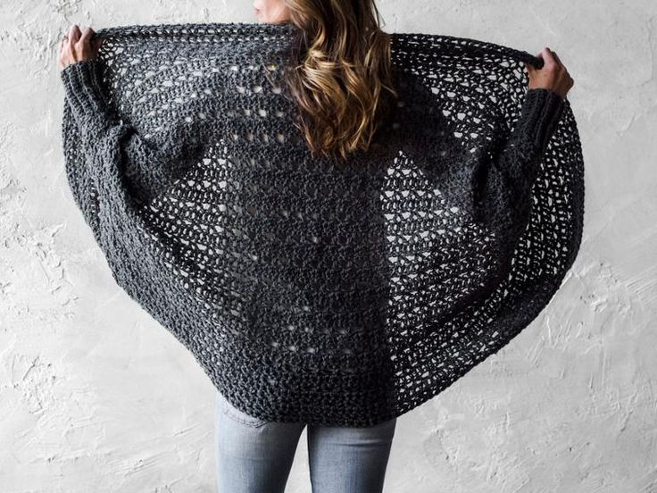 A lacy oversized sweater with batwing sleeves, ribbed cuffs, and a generous shawl collar.