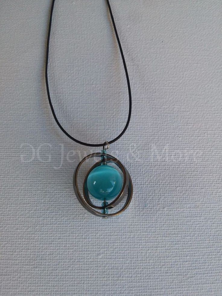 Planet Tweested Circles pendant black plated aqua cat eye adjust tinas creations #TinasCreations #Pendant