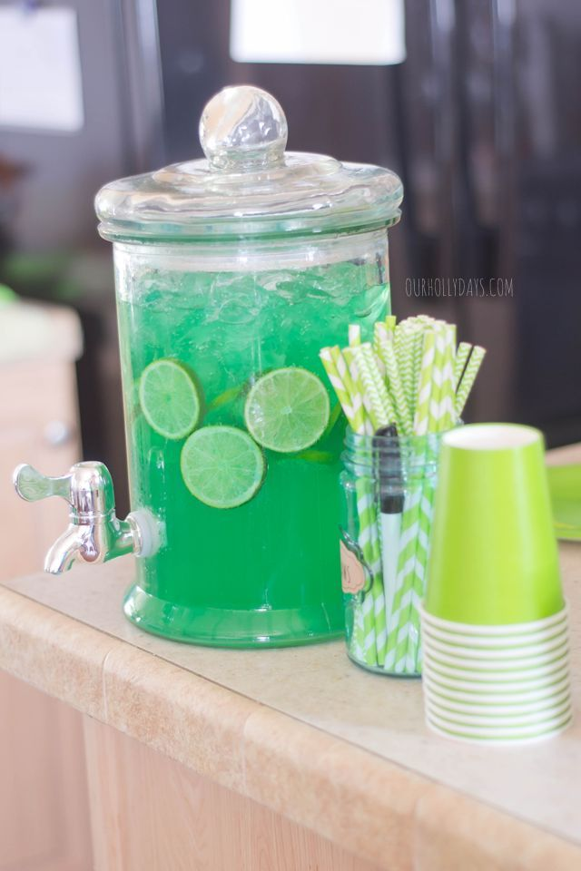 Green party punch: lemon lime pop, lemonade mix, sliced limes, green food coloring! Great for Ninja Turtle party, Hulk party, any green theme!