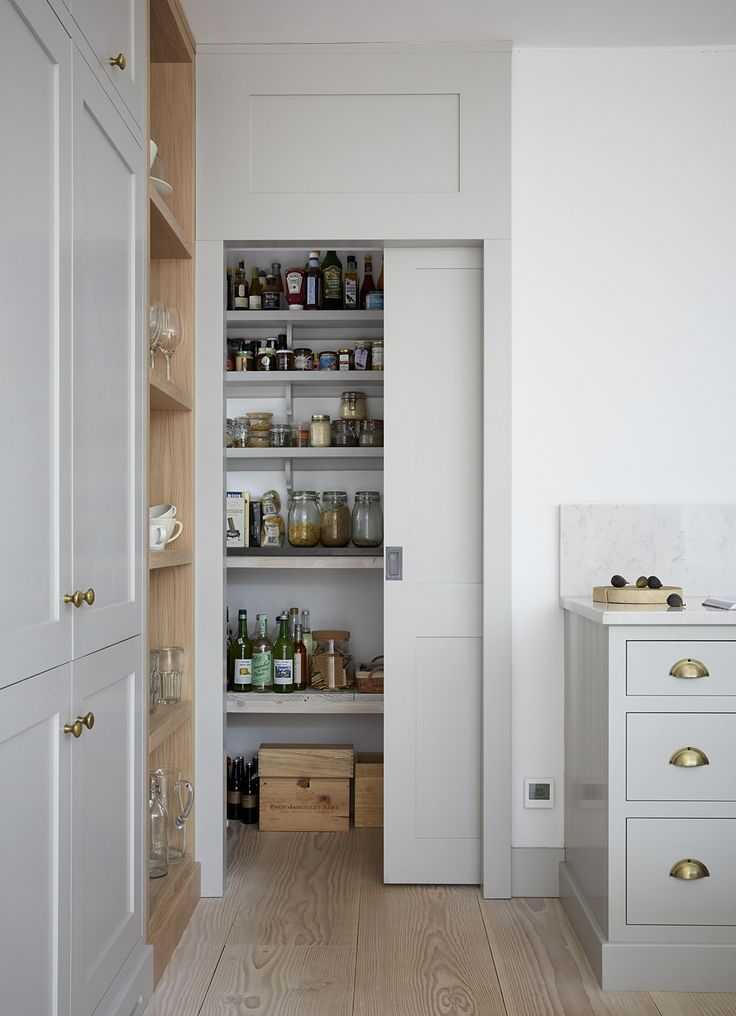 Scandinavian Cool marries well with this storage solution for the kitchen pantry. One large sliding door keeps it unfussy. #ScandinavianPantry #ScandinavianInteriors #ScandinavianDecor