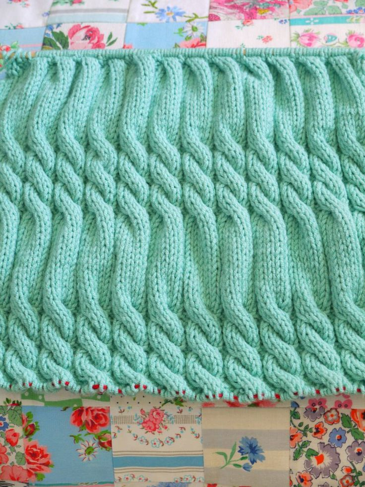 Knitted duck-egg blue cable, close-up