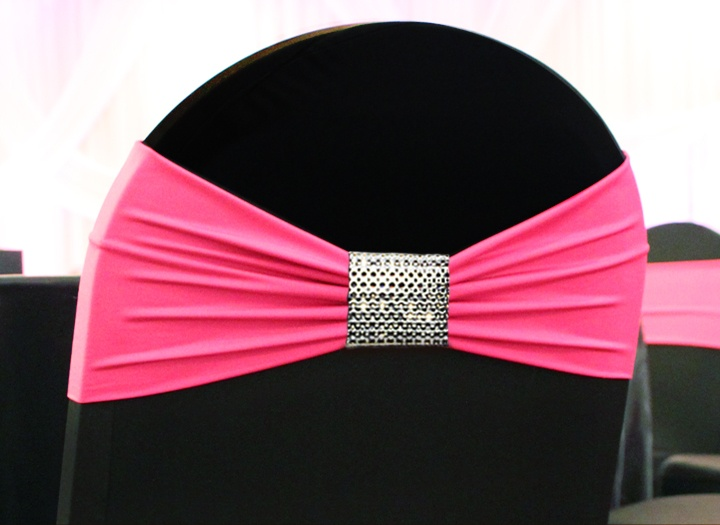 """""""Diamonds"""" wrap shown on one of our black spandex chair covers with hot pink Lycra band. Rent these at SatinChair.com"""