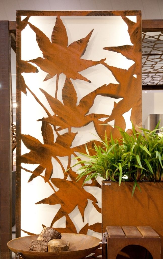 Backlit 'Maple' panel with 50mm wall-mounted feet. Rust finish.
