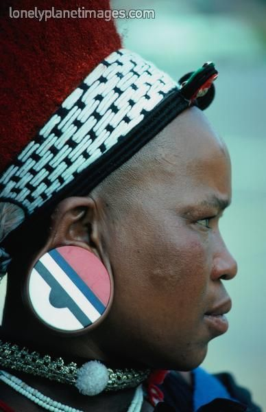 A Zulu woman from South Africa with traditional earplugs, her headdress would indicate she is married