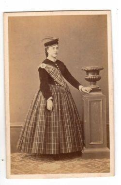 Woman in Scots themed dress, 1860-1865