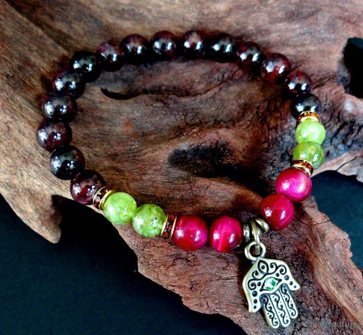 This bracelet was made of garnet peridot olivine rose tiger eye
