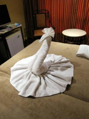 Most people have probably witnessed the art of hotel towel folding. You enter your room after a nice day at the beach and on the bed you find a sculpture; most likely of a swan, but if you are lucky you will have a cleaner who was extremely creati