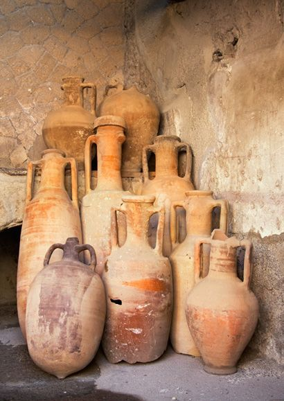 These long-necked jugs (Amphorae) were buried 50 feet below the surface of the present city of Ercolano and survived for over 1900 years before being recovered by archaeologists.   Pompeii, Italy