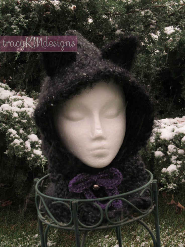 Custom kitty hooded cowl.  A little bit of fun fur at the edges!  The bow is a reflective yarn and the bell works!