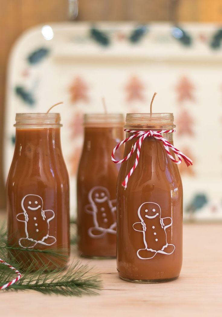 Easy to make Gingerbread Man Candles. Upcycled Starbucks Frappuccino bottles and Cricut Explore Air make these a fun project. #candlemakingdiy