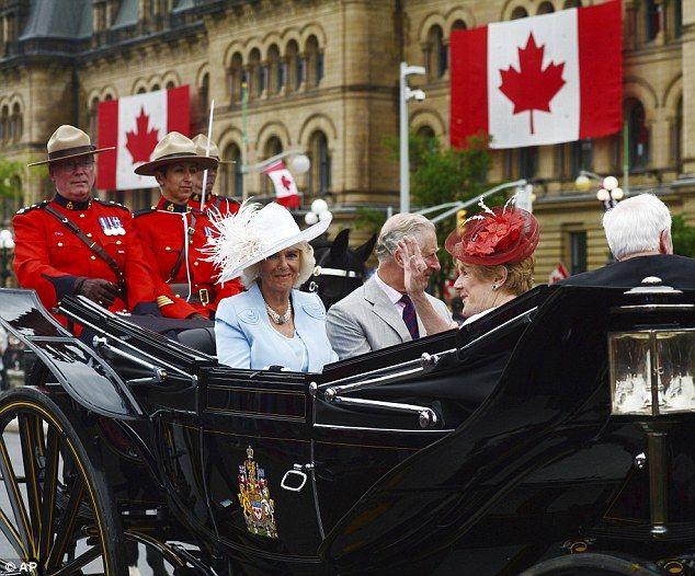 Camilla, Prince Charles, Sharon Johnston and Governor General David Johnston ride in a car...