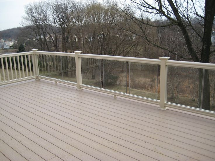 Composite deck with glass rail munz construction decks for Composite decking and railing