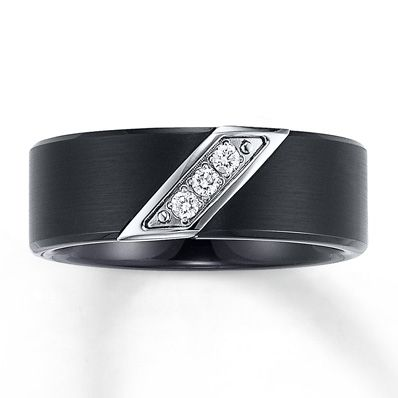 A trio of round diamonds, with a total diamond weight of 1/10 carat, is set diagonally in a tungsten carbide band in this men's 8mm wedding band. The fine jewelry ring is Supreme-Fit™ for maximum comfort. Tungsten carbide is made from a patented formula and is prized for its strength and durability. Diamond Total Carat Weight may range from .085 - .11 carats.