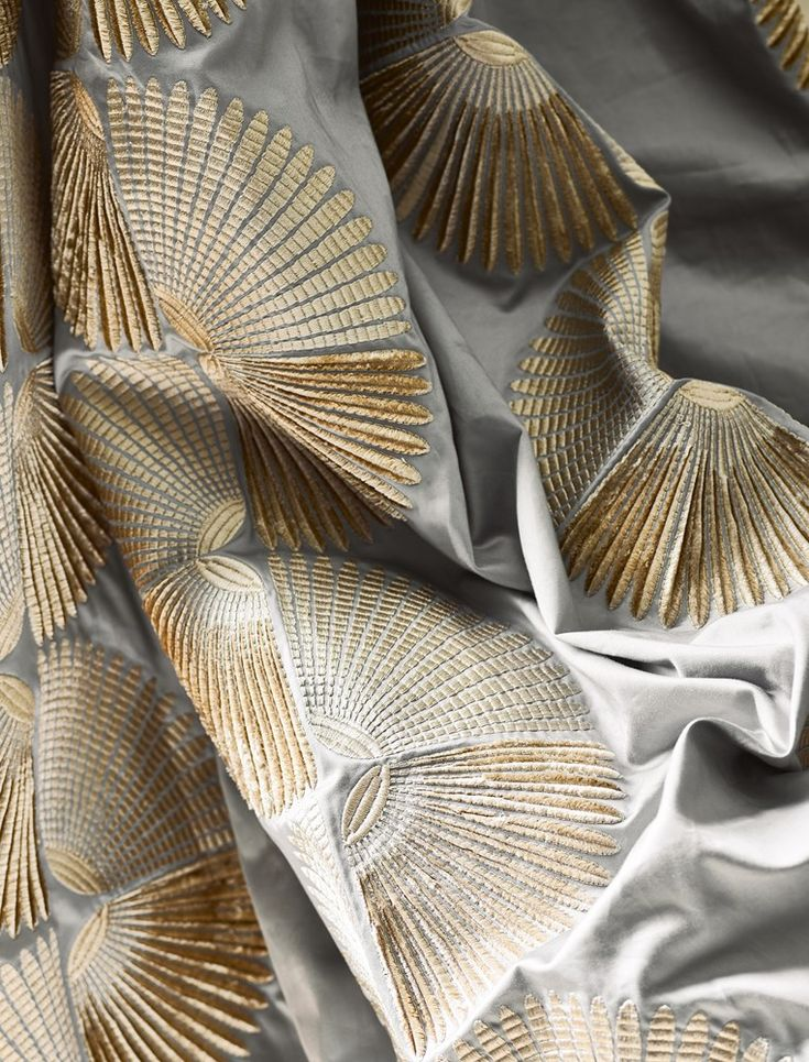 The Tamara fabric from Jane Churchill embodies luxury and elegance with its geometric fans and satin feel.