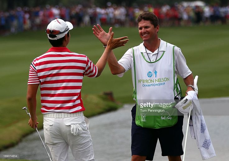 Sang-Moon Bae of South Korea celebrates with his caddie Matt Minister after winning the 2013 HP Byron Nelson Championship at the TPC Four Seasons Resort on May 19, 2013 in Irving, Texas.