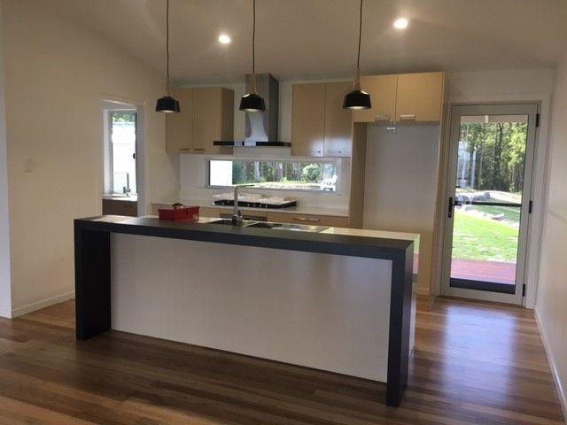 Modern Kitchen with fixed panel splash back in our Oceanview single storey design built in the Sunshine Coast Hinterland   Tru-Built Builders Queensland
