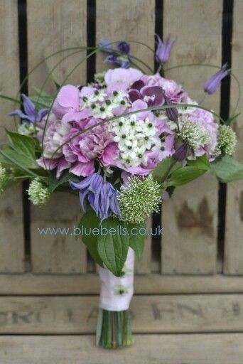 Bridal bouquet of hydrangea, clematis, chincherinchee, carnations, trachelium and orchids