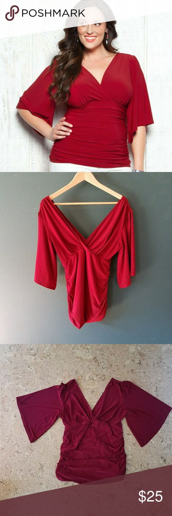 Kiyonna red kiera top Red and ready! This is an amazing top from a company that is perfecting dressing the curvy woman. If you are a buxom beauty, this will show off your best assets and conceal any midriff mishaps with forgiving ruching. Loose modernized butterfly-style sleeves cover upper arms. Kiyonna Tops
